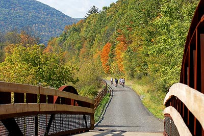 Bicyclists enjoy the PA Grand Canyon from the Pine Creek Rail Trail.