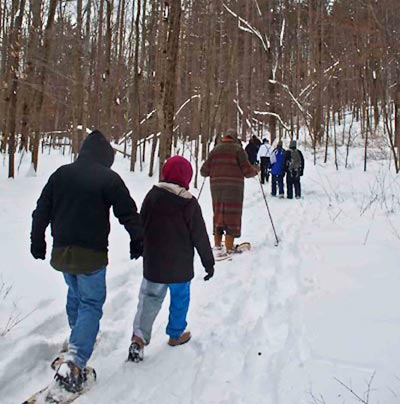 Visitors enjoy hiking and snowshoeing in snowy Wellsboro, PA