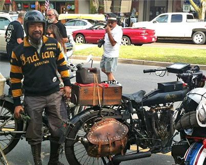 Shinya Kimura arrives at the Penn Wells on his 1915 Indian Twin motorcycle during the 2012 cross-countryCannonball.